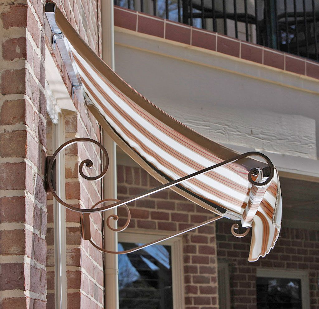 Gorgeous charleston awning with decorative supports window