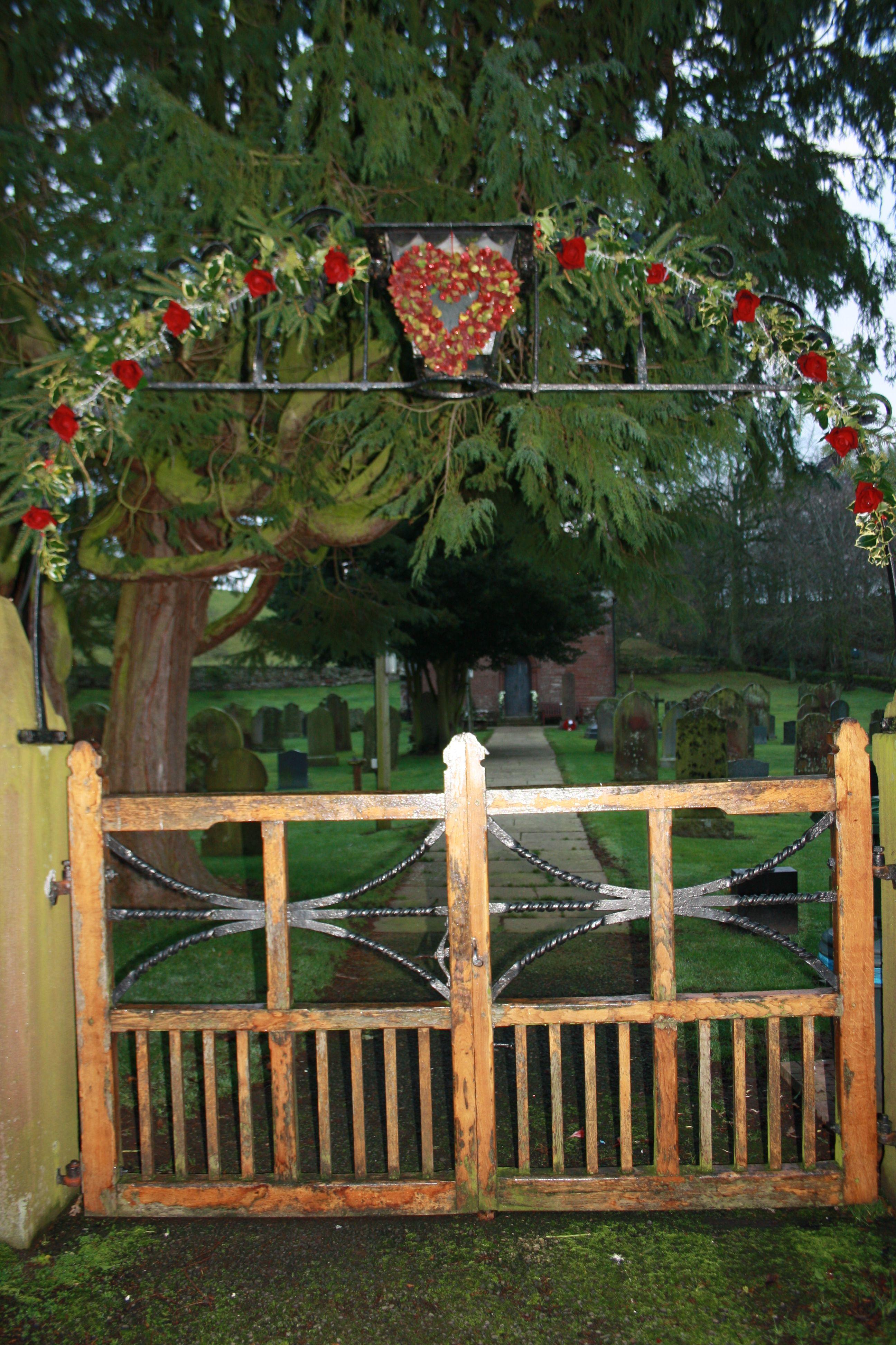 Winter Wedding Church Gate Flowers Fresh Greenery With Silk Red