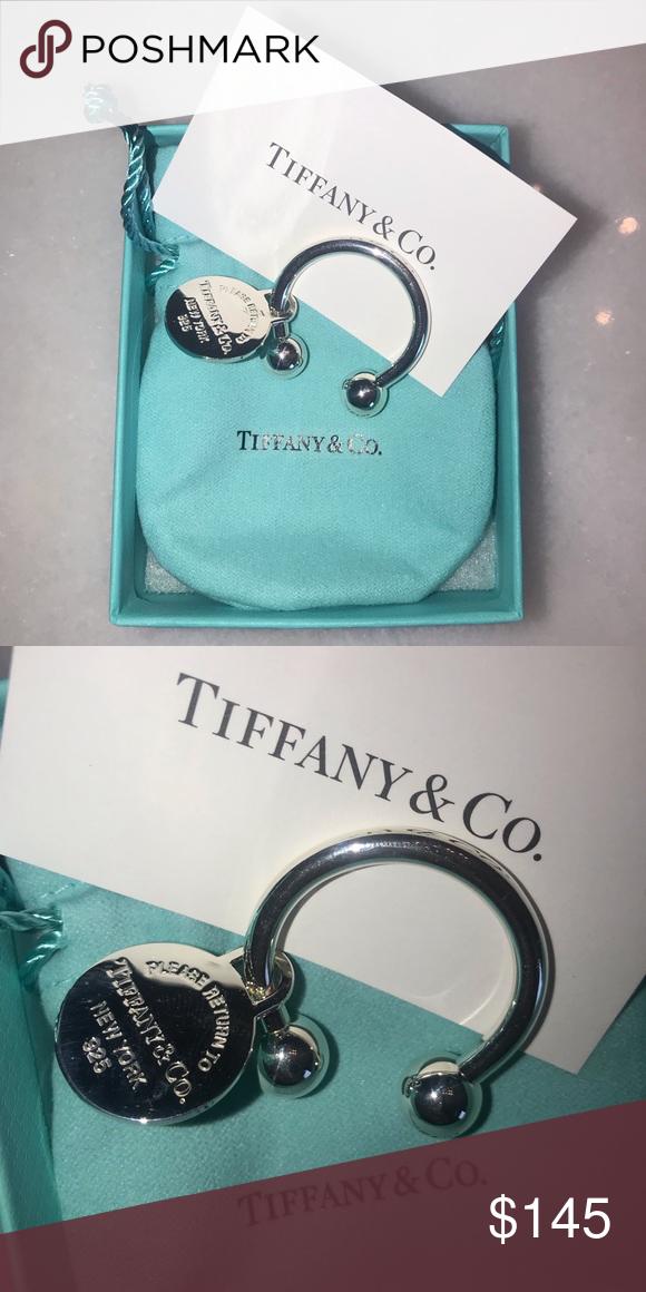 "0ebc9f1fb Tiffany & Co Round Tag Key Ring Return to Tiffany Small Round Tag Key Ring.  Measures about 1"" with tag measuring 0.75"" Tiffany & Co."