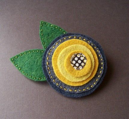 felt flowers-sewn onto cute clothes