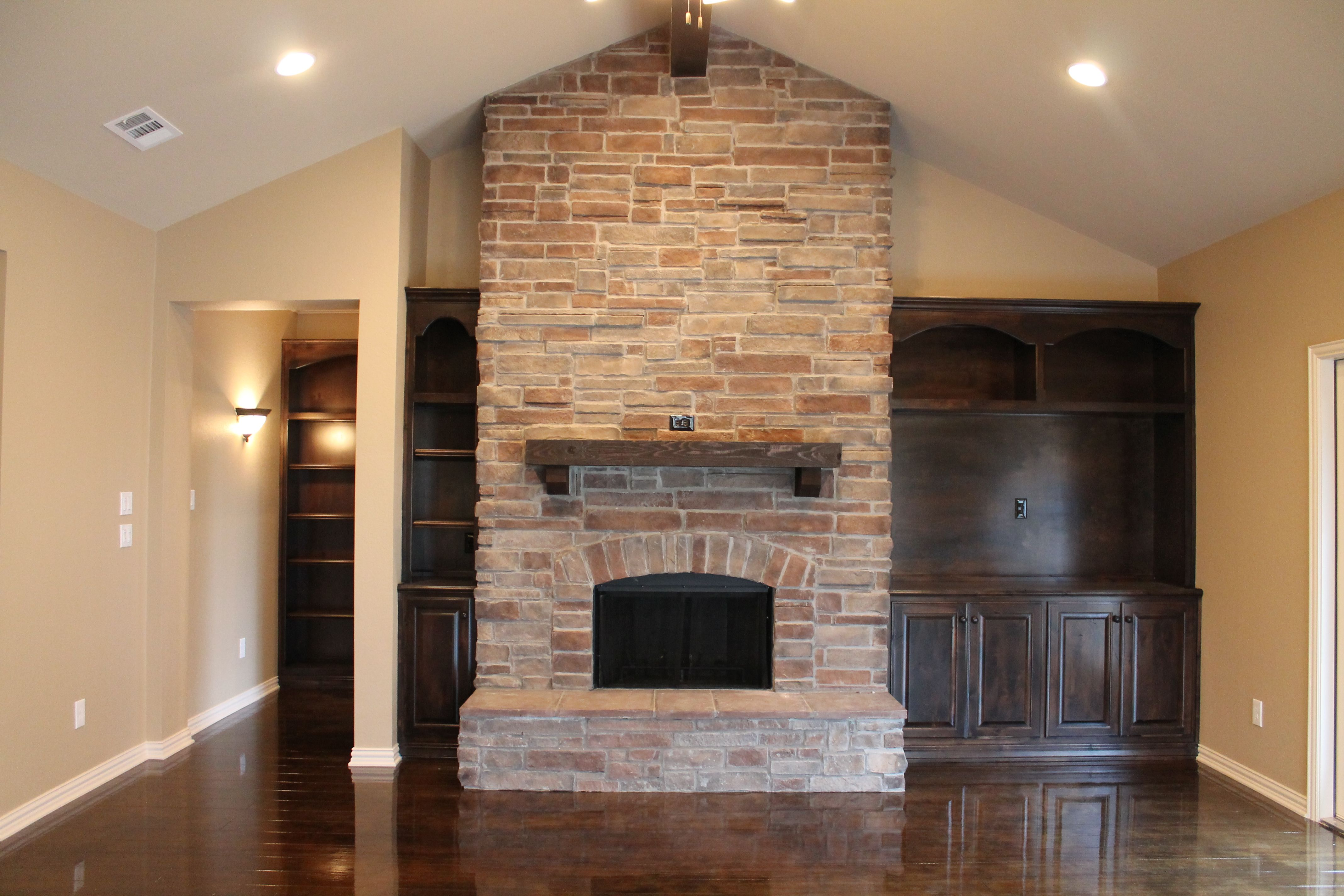 Stone Fireplace Custom Wood Stained Built Ins And Concrete Floors That Look Like Wood Make This