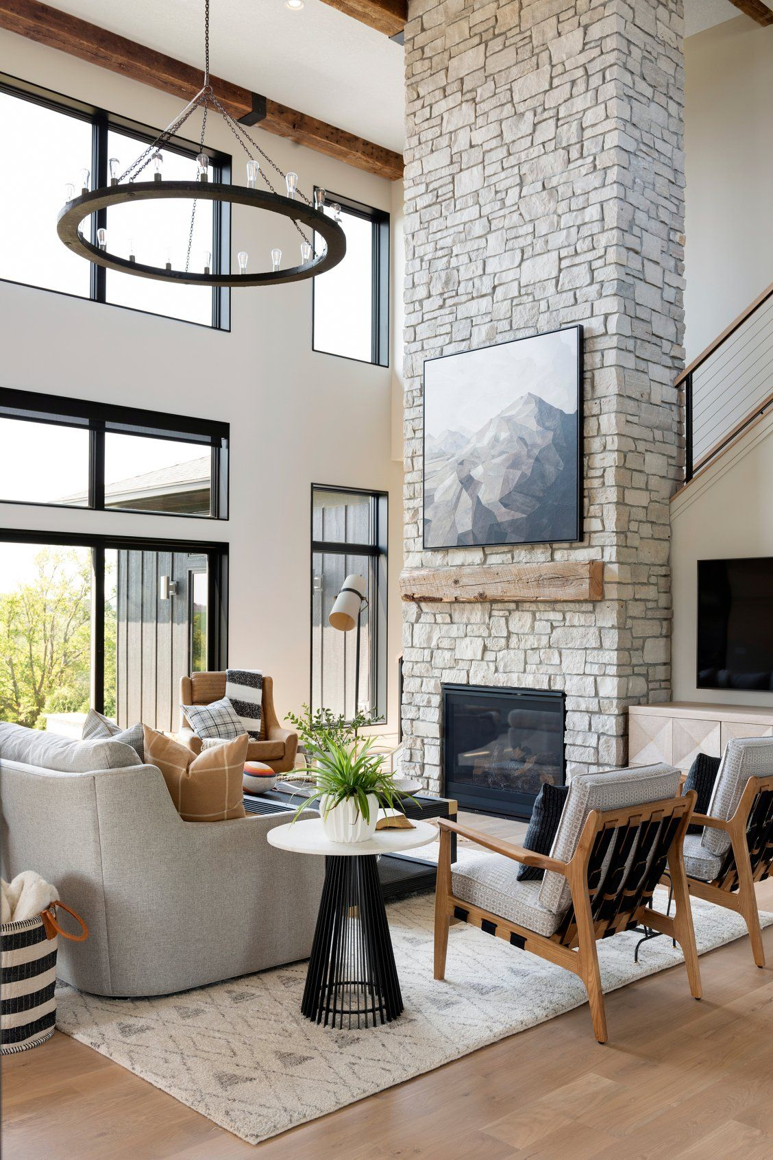 Living Room With Floor To Ceiling Windows And A Floor To Ceiling Stone Fireplace In 2020 High Ceiling Living Room Farm House Living Room Brick Fireplace Makeover
