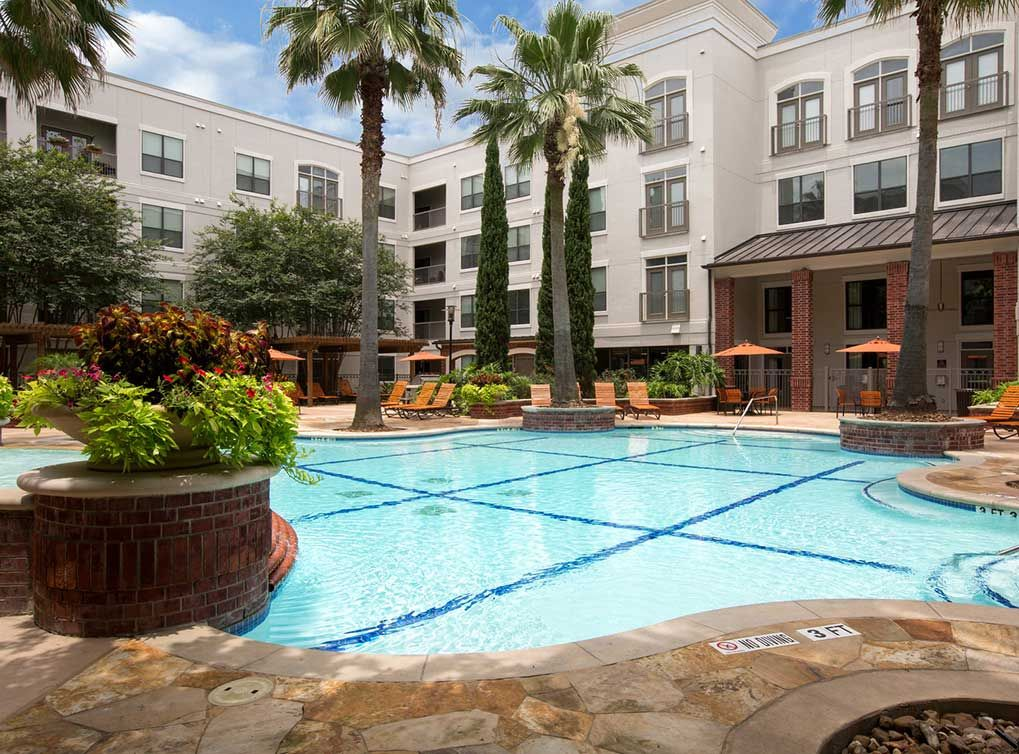 Lounge Beside The Luxury Pool At Amli City Vista An Amenity Driven Apartment Community In Houston Luxury Pool Vista Apartment Communities