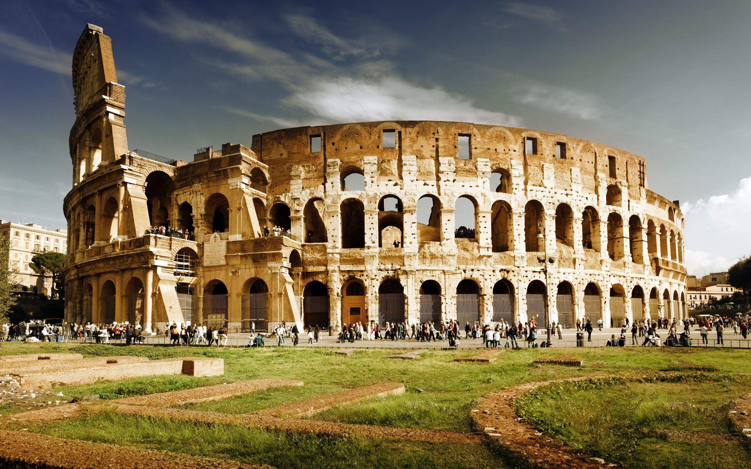 sunset clouds architecture grass people buildings Rome Colosseum arena skies  / 2560x1600 Wallpaper
