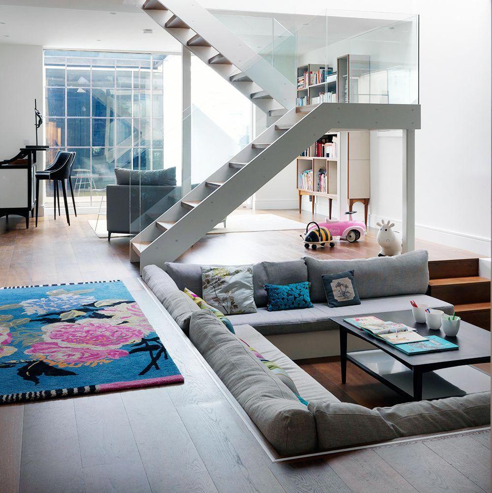 Modern open plan living room with sunken sofa  Sunken living room