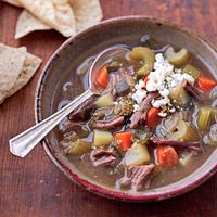 Poblano peppers, tomatillos, and cumin add South of the Border flavor to this beef soup. Top with Mexican cheese and serve with tortilla chips for dinner.
