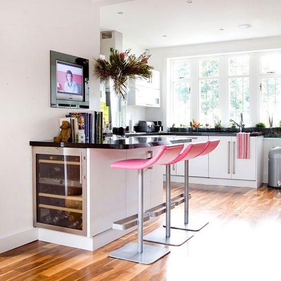 Monochrome kitchen-diner with breakfast bar