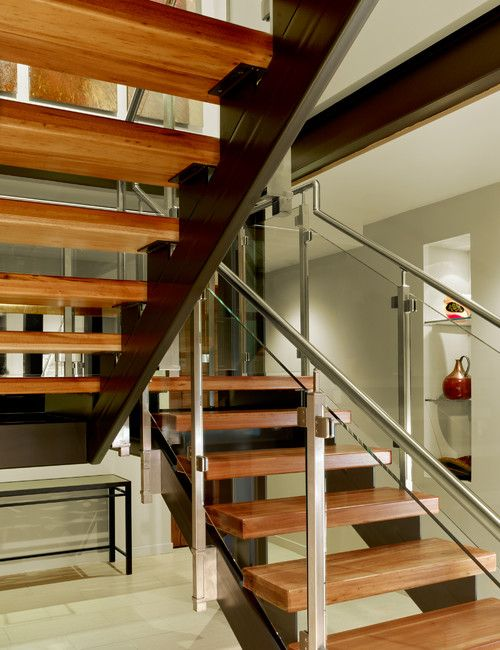 Wonderful Open Staircase With Floating Stair Treads, And A Stainless Steel U0026 Glass  Handrail. Exposed Steel Support Beams With Blackened Finish Complements The  Art ...