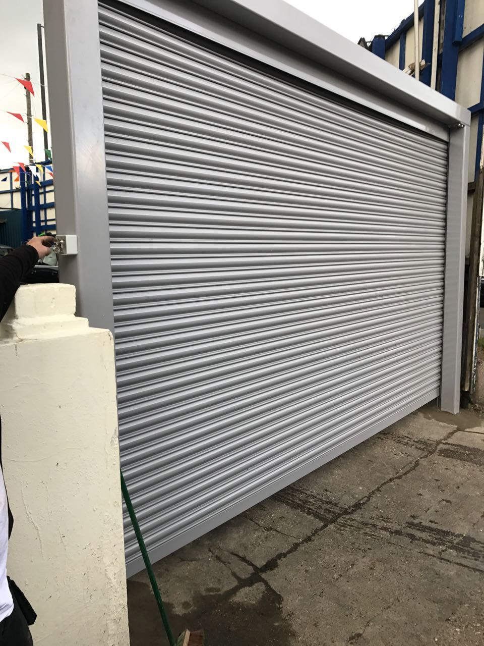 Happy Client With Our Rsg5000 Solid Steel Security Shutter With Goal Post Fitted To His Car Wash Company In Harrow Ht Roller Shutters Shutters Door Treatments