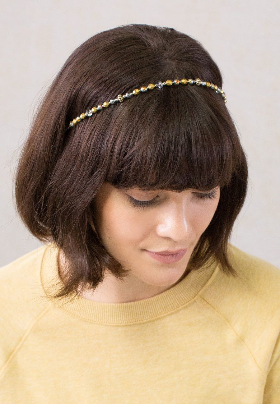 """Angel Wings"" Headband has golden metallic, silver, and brass accents. Removable adjustable comfort elastic band available in Black, Blonde, Brunette, or Silver"