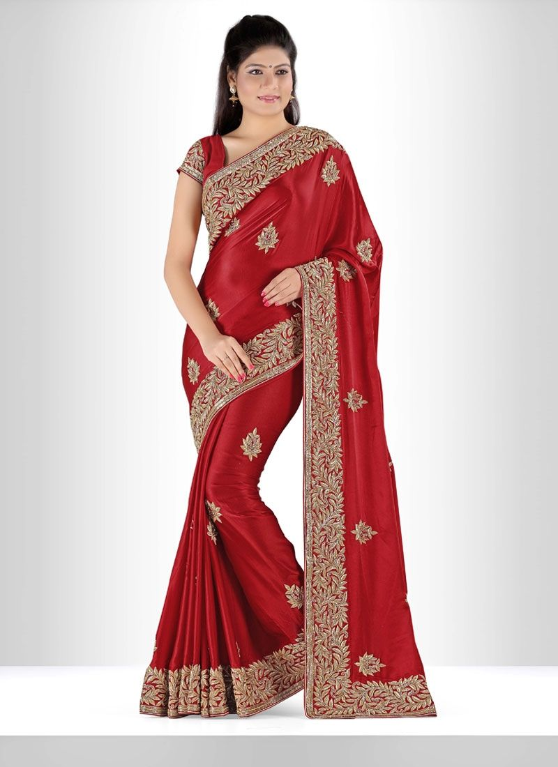 Enchant the mantra of being stylish in this attire. Women beauty is magnified tenfold in this alluring satin designer saree. This attire is nicely designed with cut dana and kasab work comes with matc...