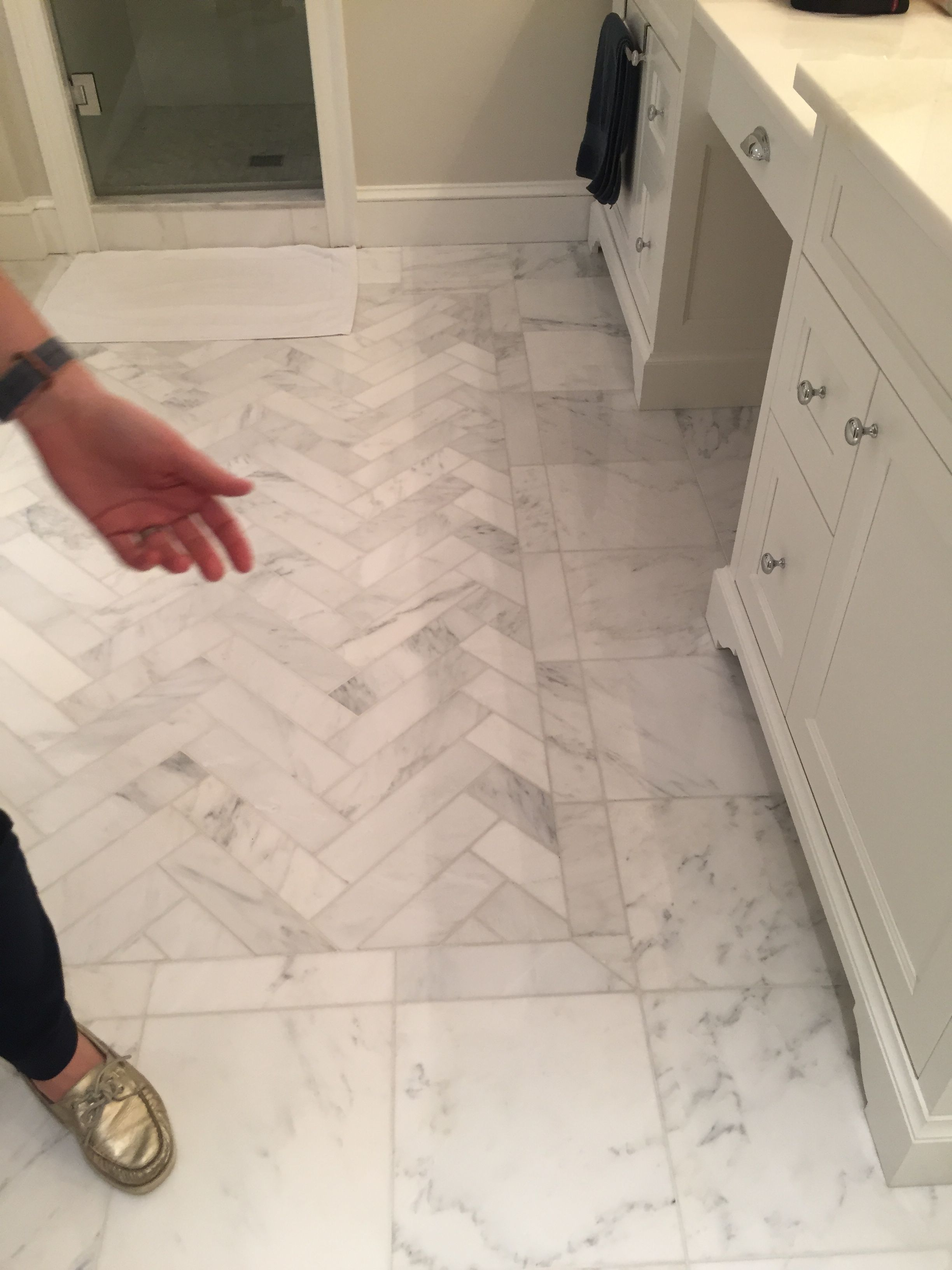 Herringbone Pattern Inset Surrounded By 12x12 White Carrara Floor Tiles Bathroom Floor Tile Patterns Floor Tile Patterns Entryway Patterned Floor Tiles