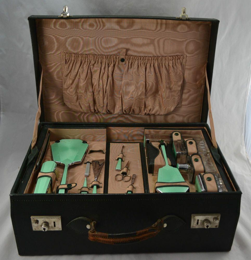 1930s Vintage ladies leather suitcase with 13 piece green enamel vanity set