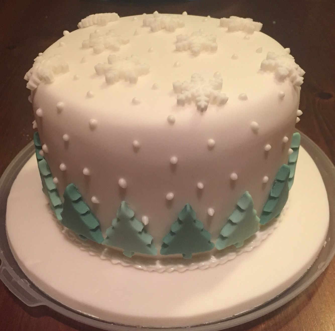 Christmas Cake with trees and snowflakes and royal icing
