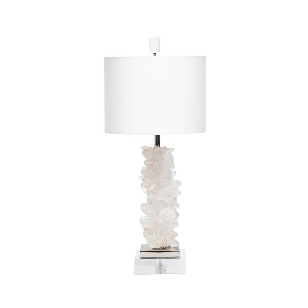 Handcrafted lamp with quartz crystal points on a metal riser with an