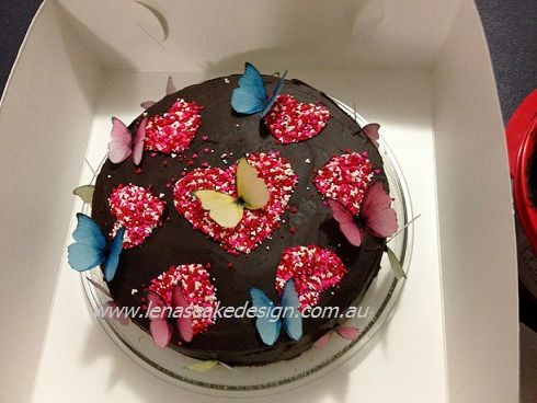 Chocolate cake decorated with edible butterflies by Lena's Cake Design. http://lenatambo.blogspot.com