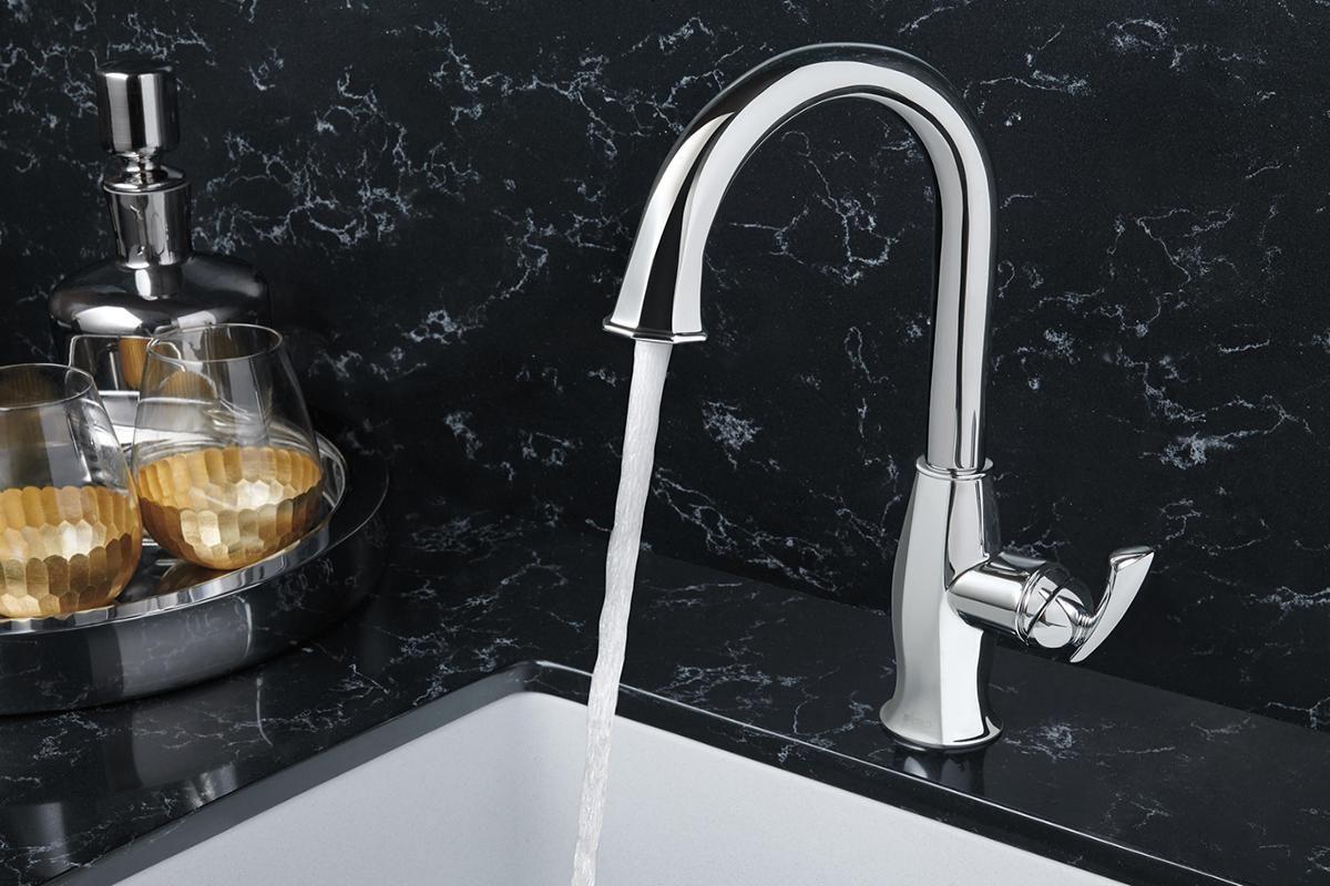 This symmetrical stainless Brizo Coltello single hole bar faucet ...