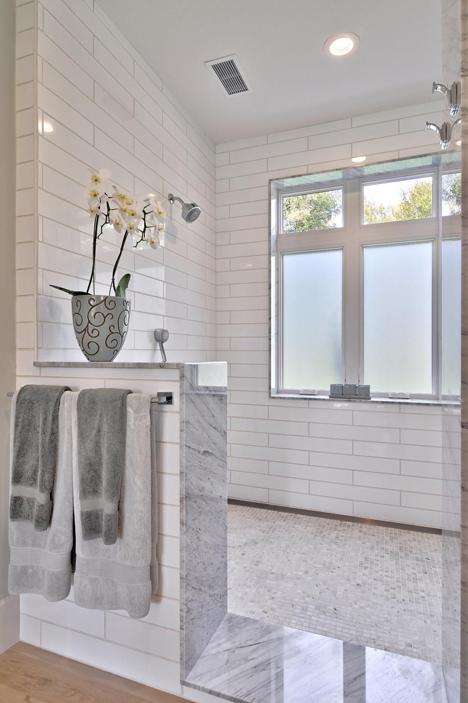 Classic White Subway Tiles And A Small Potted Plant Bring Charm To The Elegant Materials And Modern D Farmhouse Shower Window In Shower Bathroom Remodel Master