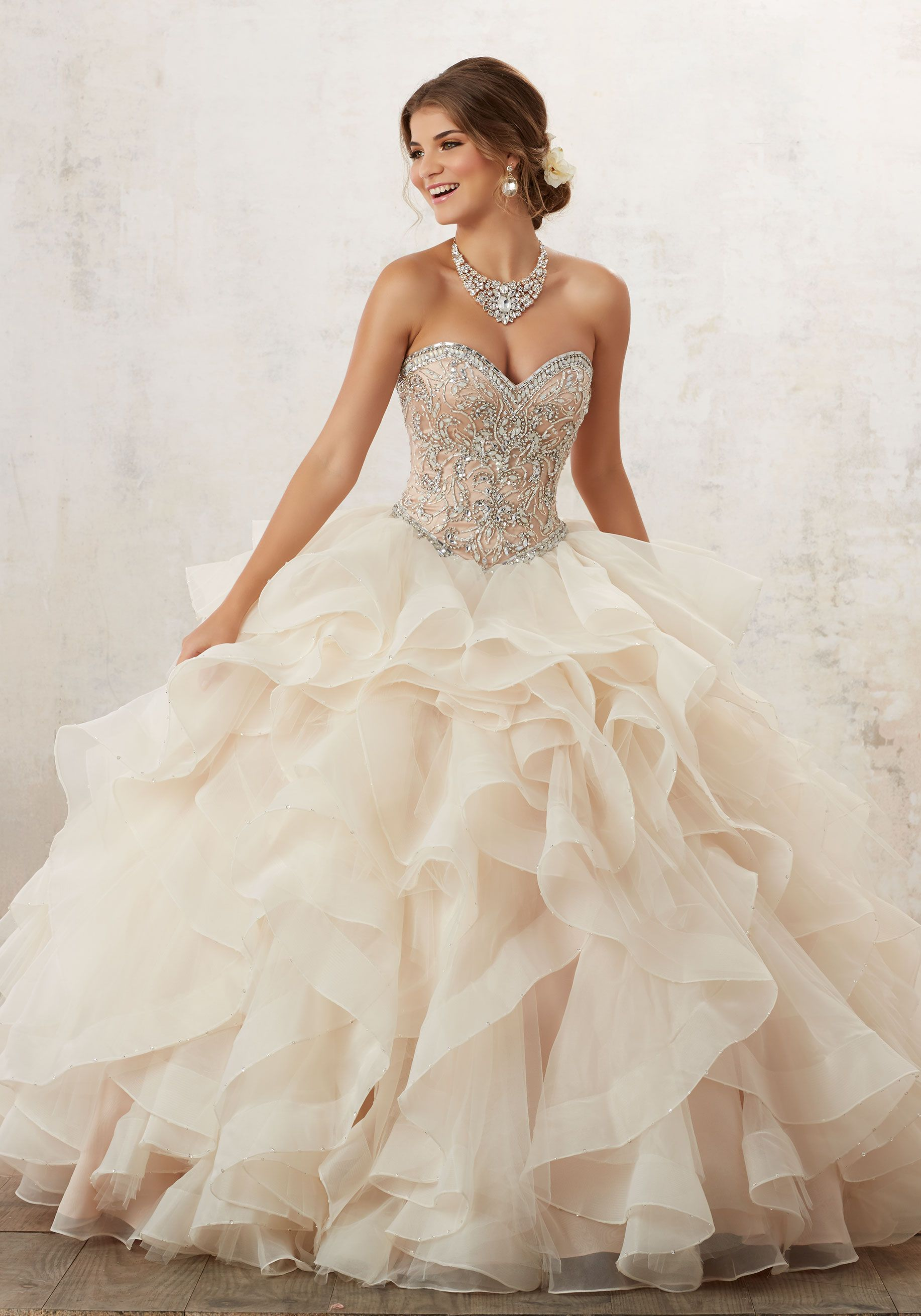 cb7047132a72 Classic Quinceañera Ballgown Combines a Stunning Jewel Beaded Sweetheart  Bodice, and Full Ruffled Skirt Accented with Delicate Beading. Corset Back.