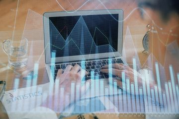 Multi exposure of market chart with man working on computer on background Concept of financial analysis