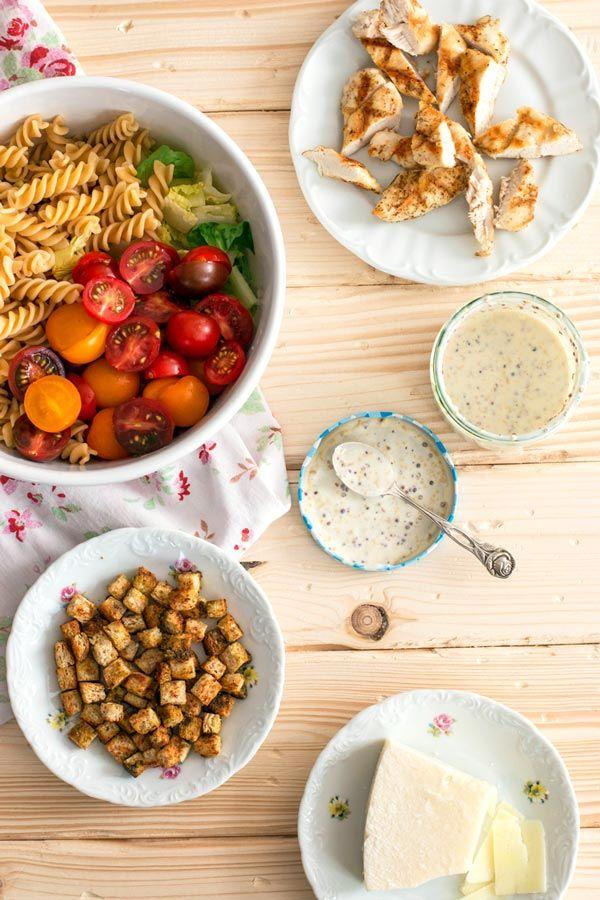 Ingredients for a lighter chicken caesar pasta salad.