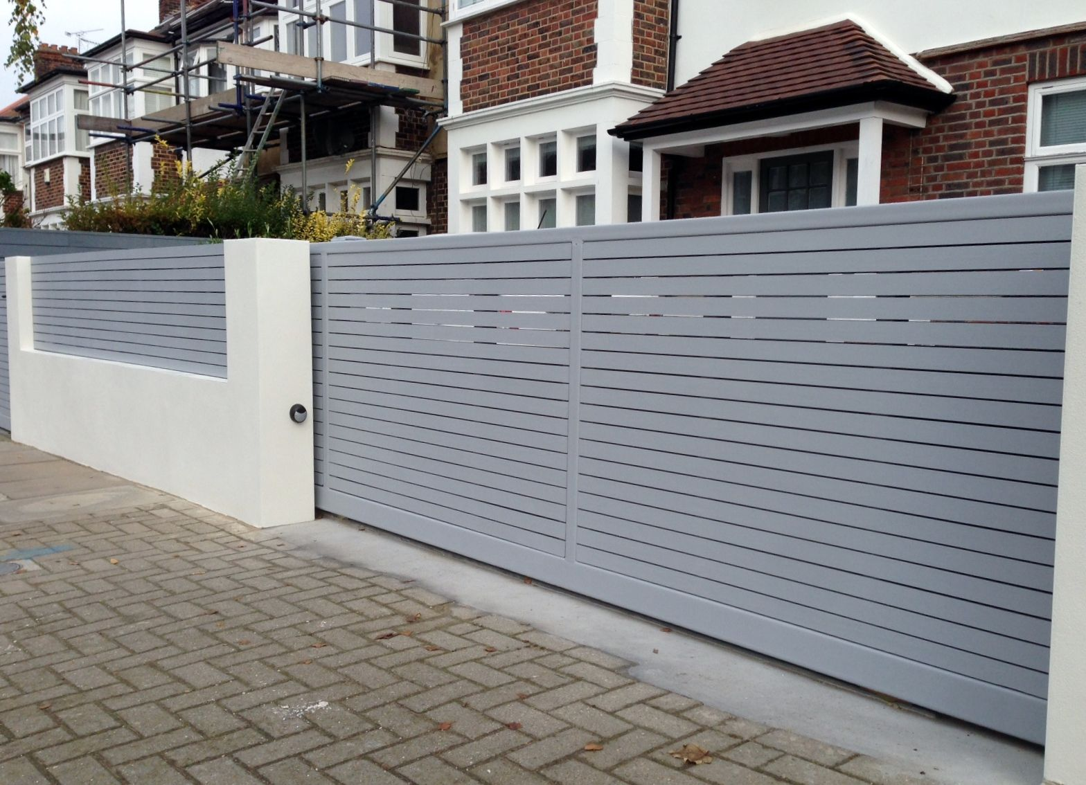 Front boundary wall screen automated electronic gate installation grey wooden fence bike store modern garden design balham clapham london contact anewgarden