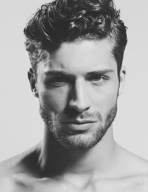 Thick  short curly hairstyle for men with stubble beard   www - peinados hombre