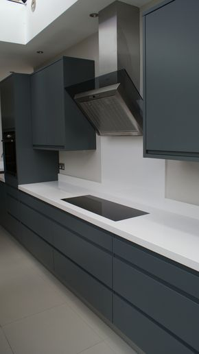 Graphite grey modern kitchen with White Silestone work tops, designed and fitted by Orchardkitchens.com #greykitcheninterior