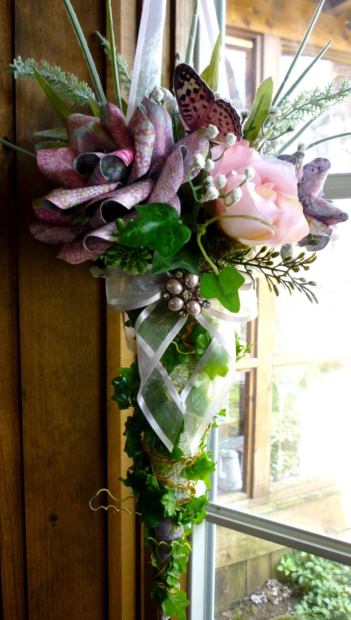 Paper roses in a cone arrangement