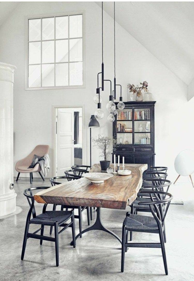black wishbone chairs and a cork table in the kitchen / Stadshem ...