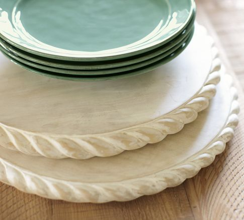 Intricate and artful rope carvings decorate this acacia charger to bring nautical appeal to the summer table. Place it beneath a ceramic plate for a unique place setting