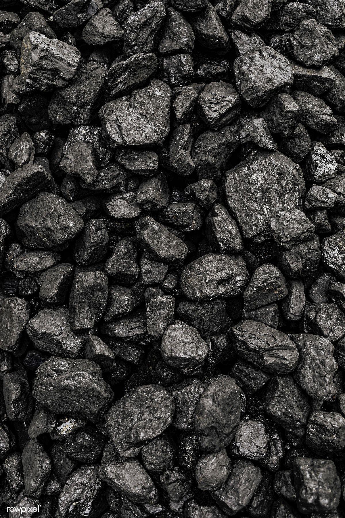 Download premium photo of Black pebbles macro shot