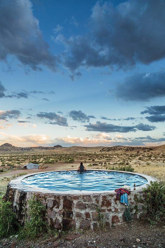 Awesome stone water tank converted into a pool on a family - Convert swimming pool to rainwater tank ...