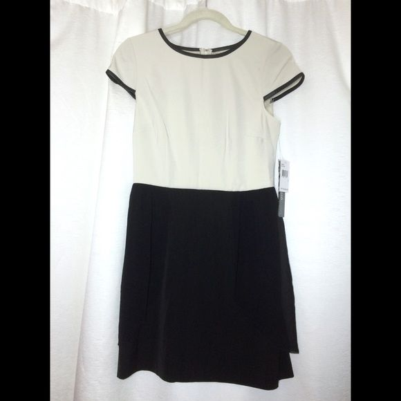 NWT Kensie Short Sleeve Dress Size 6 NWT Kensie Short Sleeve Dress in Size 6 - off-white short sleeve crewneck top w/ faux leather trim; flowy black knee length bottom.  $120 new! Kensie Dresses Midi