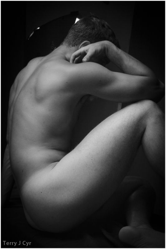 Nude man in profile