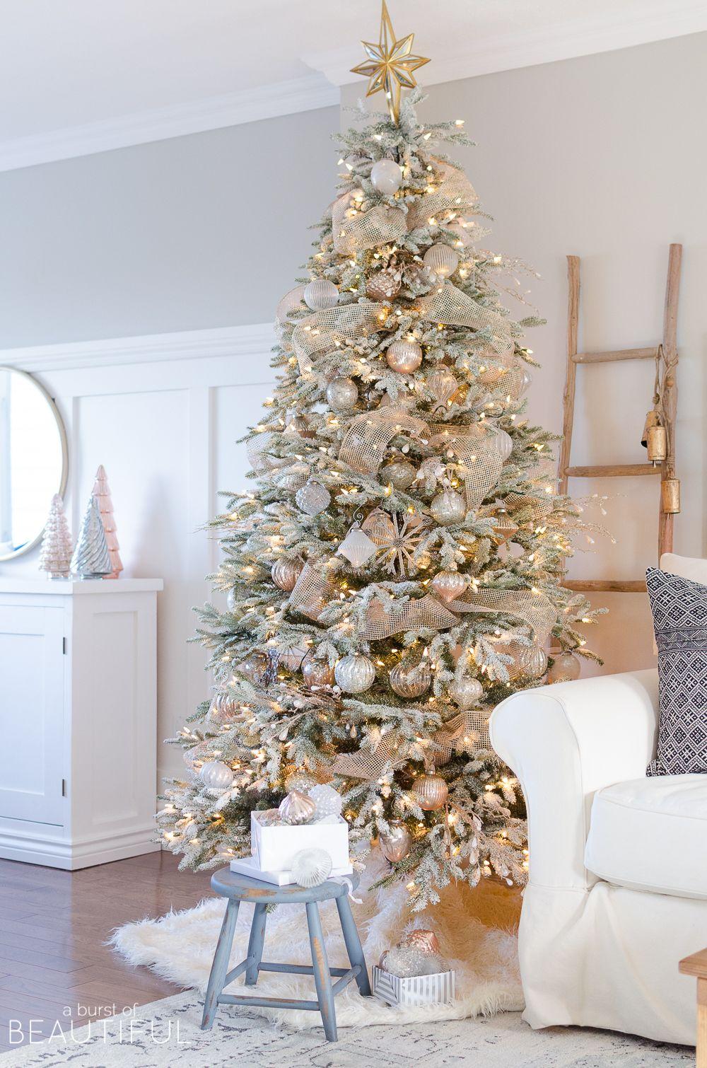 a snowy flocked christmas tree christmas christmas. Black Bedroom Furniture Sets. Home Design Ideas