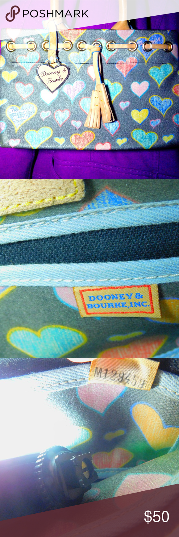 Dooney & Bourke Signature Hearts Tassel Tote Practically new it just sat in my closet. Dooney & Bourke Signature Hearts Tassel Tote is adorbs. Its grey and has a multi colored crayon heart design a brown leather lace through top and tassels.  I love the sturdy handles and magnetic snap closure. The hearts are colored yellow, purple, blue, and pink so it goes with everything and lets not forget that super cute pink enamel heart. Dooney & Bourke Bags Totes #crayonheart