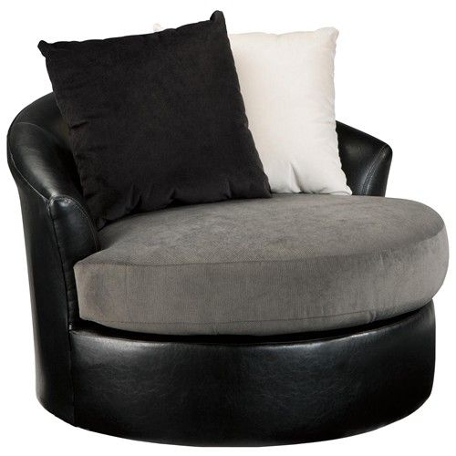 Armant Swivel Accent Chair with 2 Pillows and Faux Leather/Fabric Upholstery by Signature Design by Ashley