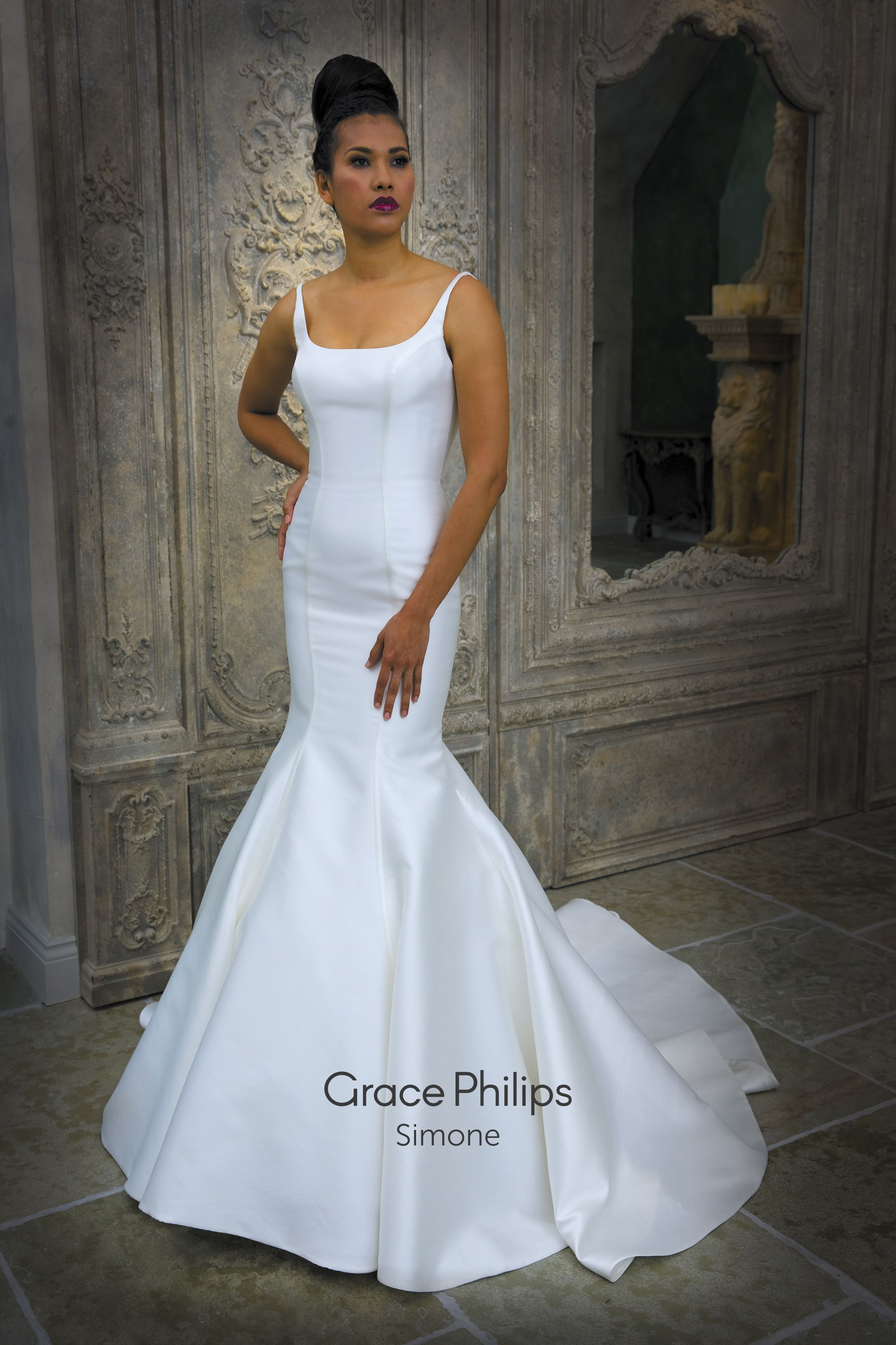 A Tailored Mikado Fishtail Wedding Dress With Simple Seam Detailing And Two Metre Long Train