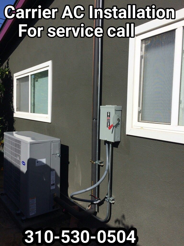 Carrier Slim Line Condenser on the side of the house in the city of