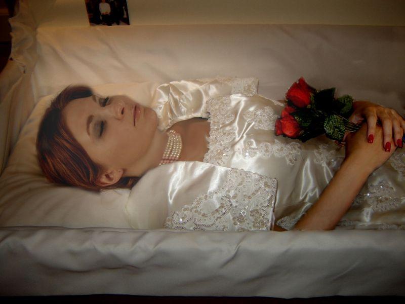 Woman in her open casket at a fantasy funeral. | Dead body ...