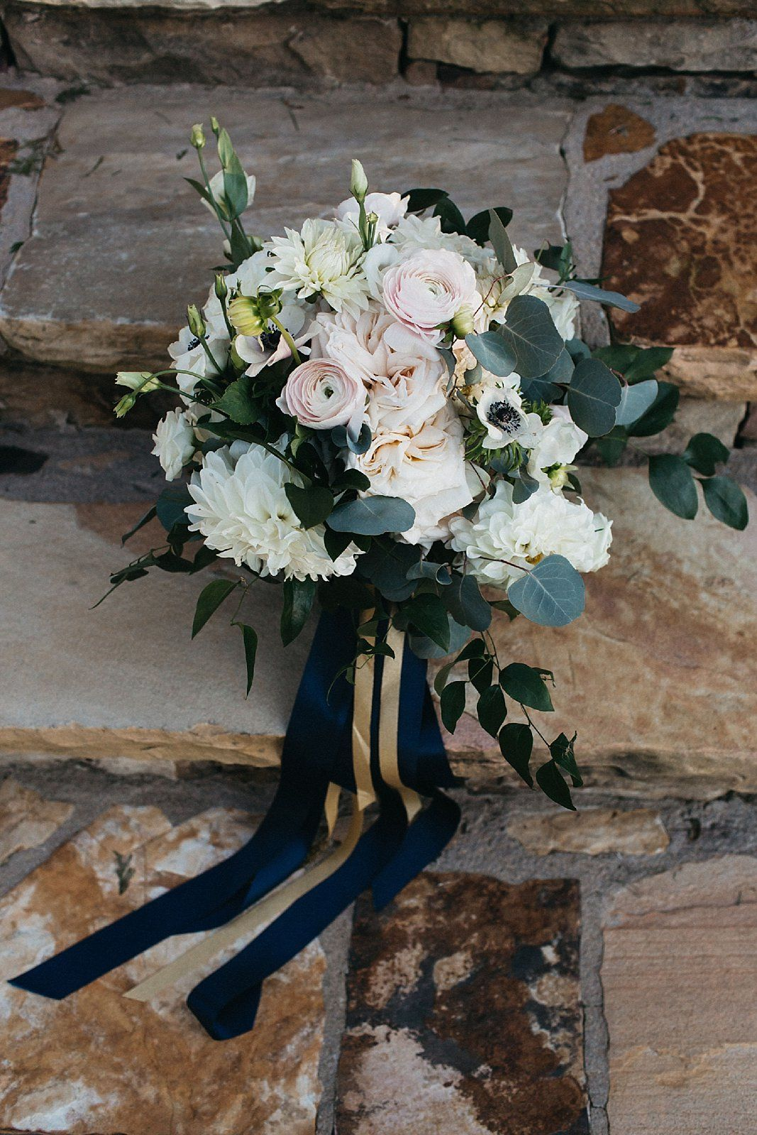pink and ivory wedding bouquet with navy ribbon. romantic