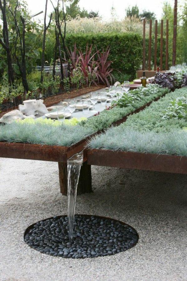 gartengestaltung mit kies gartentisch bauen pflanzen holz wasser - garten brunnen stein ideen