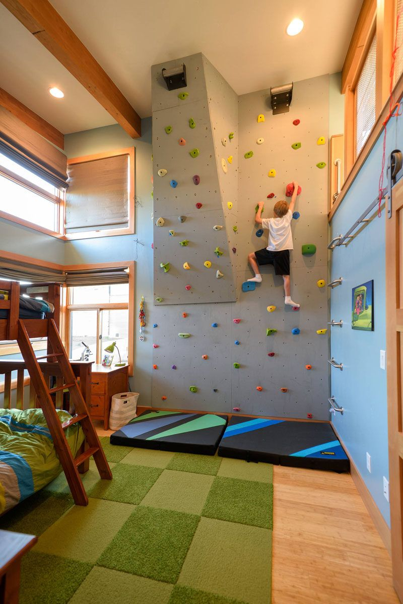 This rock climbing wall in a kids bedroom has a couple of angles in it to give you the option of increasing the challenge of the climb when one route starts