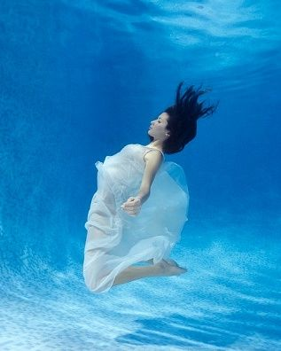 6dadc874a6 Young Woman Wearing Whire Dress Floating Underwater - Royalty Free Images,  Photos and Stock Photography :: Inmagine