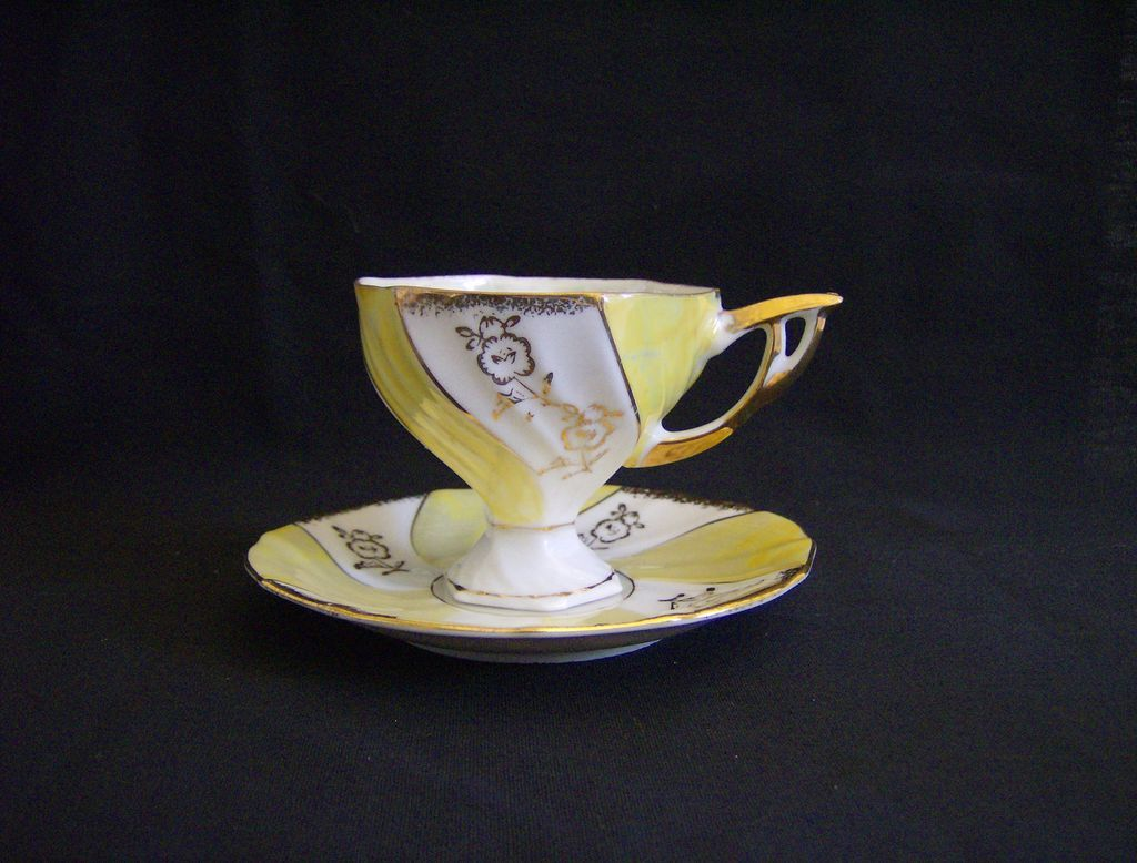 Mother Of Pearl Hand Painted Tea Cup and Saucer