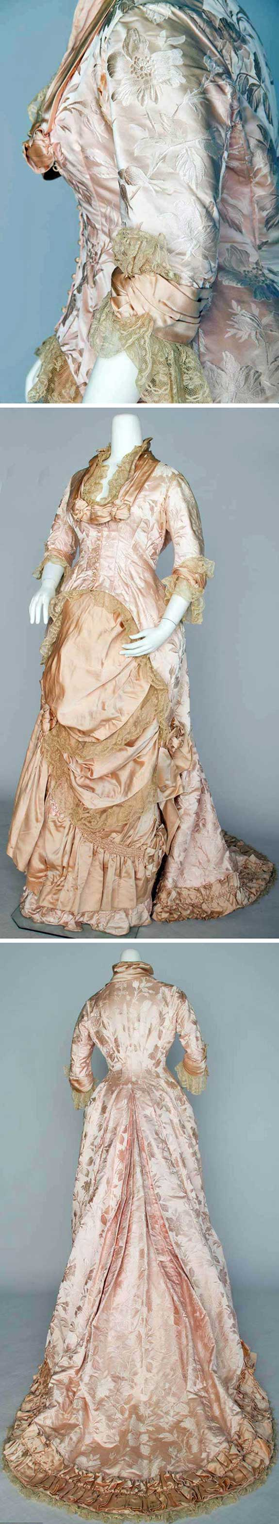 Pink reception gown, ca. 1880s. One piece, with long fitted bodice, & trained skirt. Pink satin and Valenciennes lace trim. Augusta Auctions