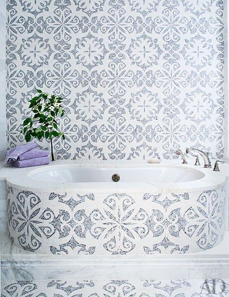 The master bath, decorated with mosaic tilework, has a BainUltra tub | archdigest.com