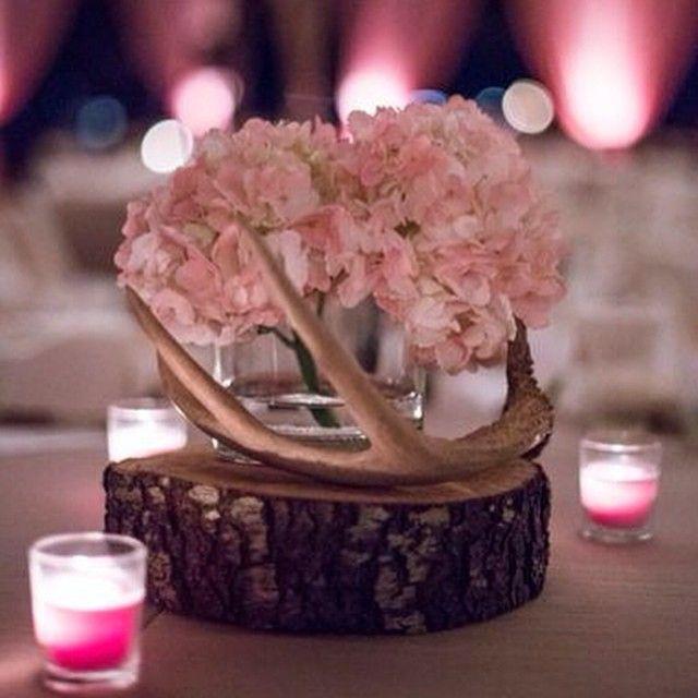 Oooh La La... Antlers! #antler #antlercenterpiece #wood #woodslice #candles #countrywedding #huntingwedding #backwoodsblessed