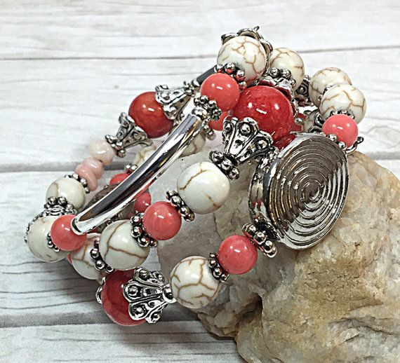 This pink coral bracelet is truly spectacular. This rustic boho bracelet is the perfect gift for that special person in your life. This pink wrap bracelet is made with white turquoise beads, sterling silver plated tube beads, pink coral beads and silver-tone spacer beads and bead caps. The average bead size 8mm. This memory wire bracelet would be a great addition to your wardrobe. It can be dressed down with jeans and a t-shirt and then dressed up for the office. I create one-of–a-kind…